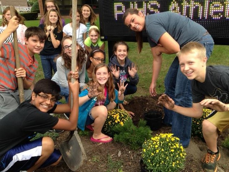 Students in School Activites (Athletics, Classrooms, Plays, Band, Art Projects) (PJHS Students Landscaping.jpg)
