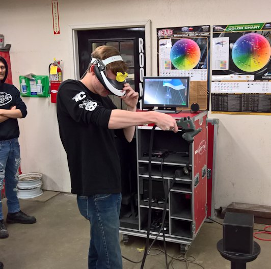 Students in School Activites (Athletics, Classrooms, Plays, Band, Art Projects) (PHS Student at Heartland Career Center Learning to Paint Auto Body with Virtual Reality.jpg)